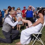 Bend-Brewfest-2015-groom-removes-garter-belt-with-teeth